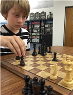 Student playing chess