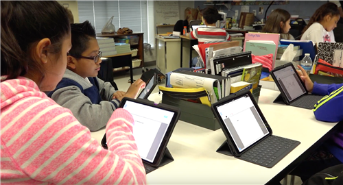 students using iPads with keyboards
