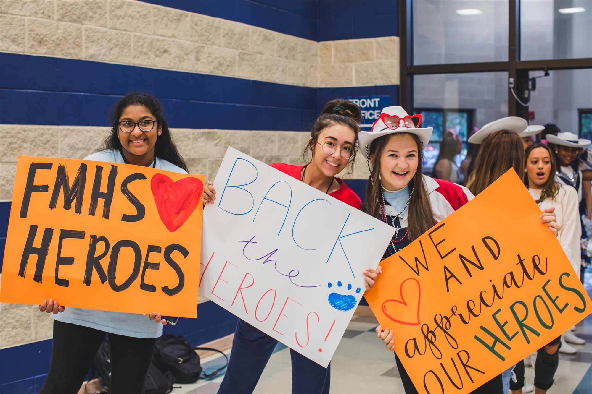 FMHS students hold thank you signs for Back the Heroes Day. 2019