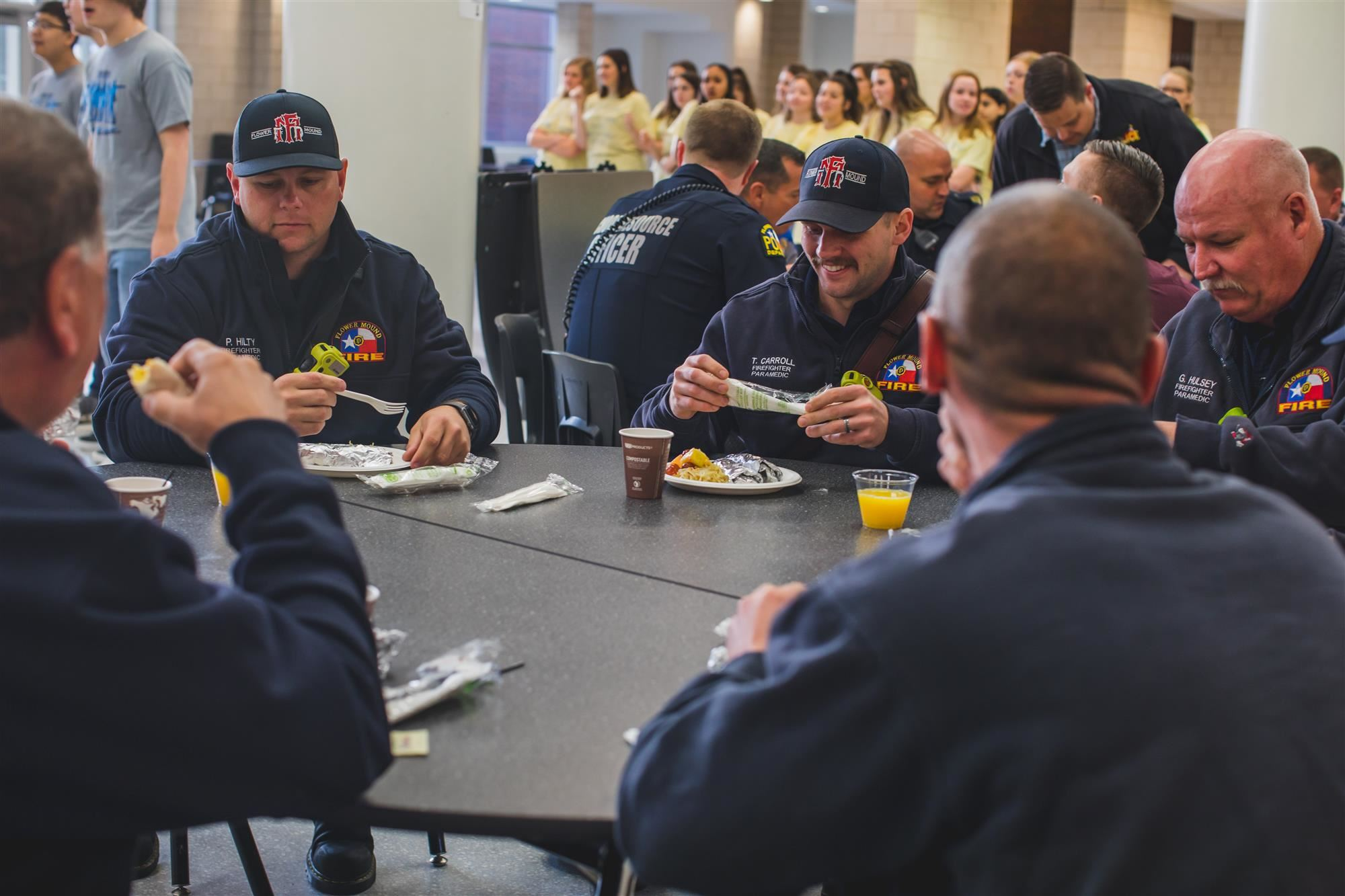Flower Mound Police Officers and Firefighters eat breakfast for Back the Heroes Day at FMHS. 2019