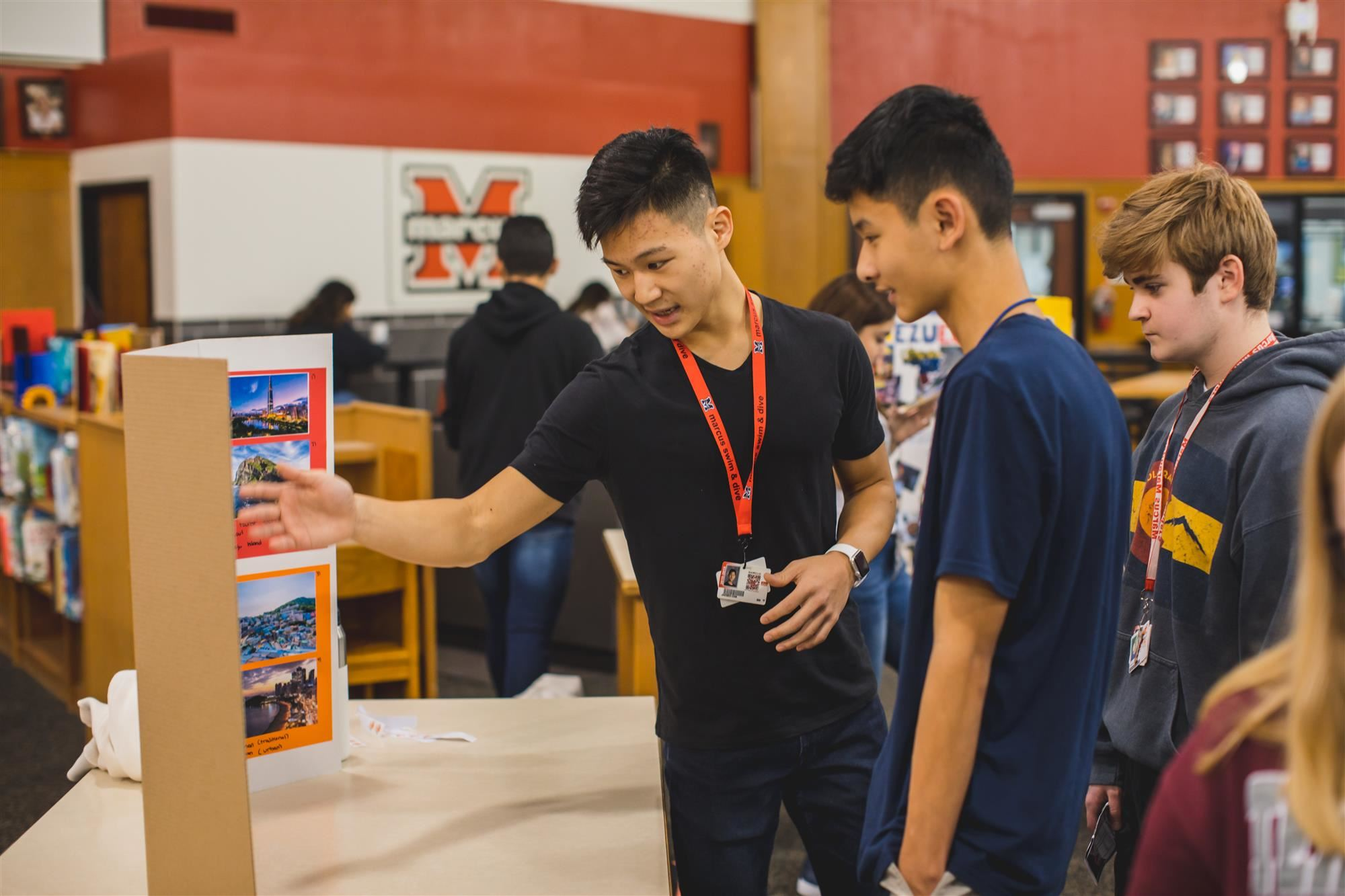 MHS student talks to fellow students about South Korea. 2019