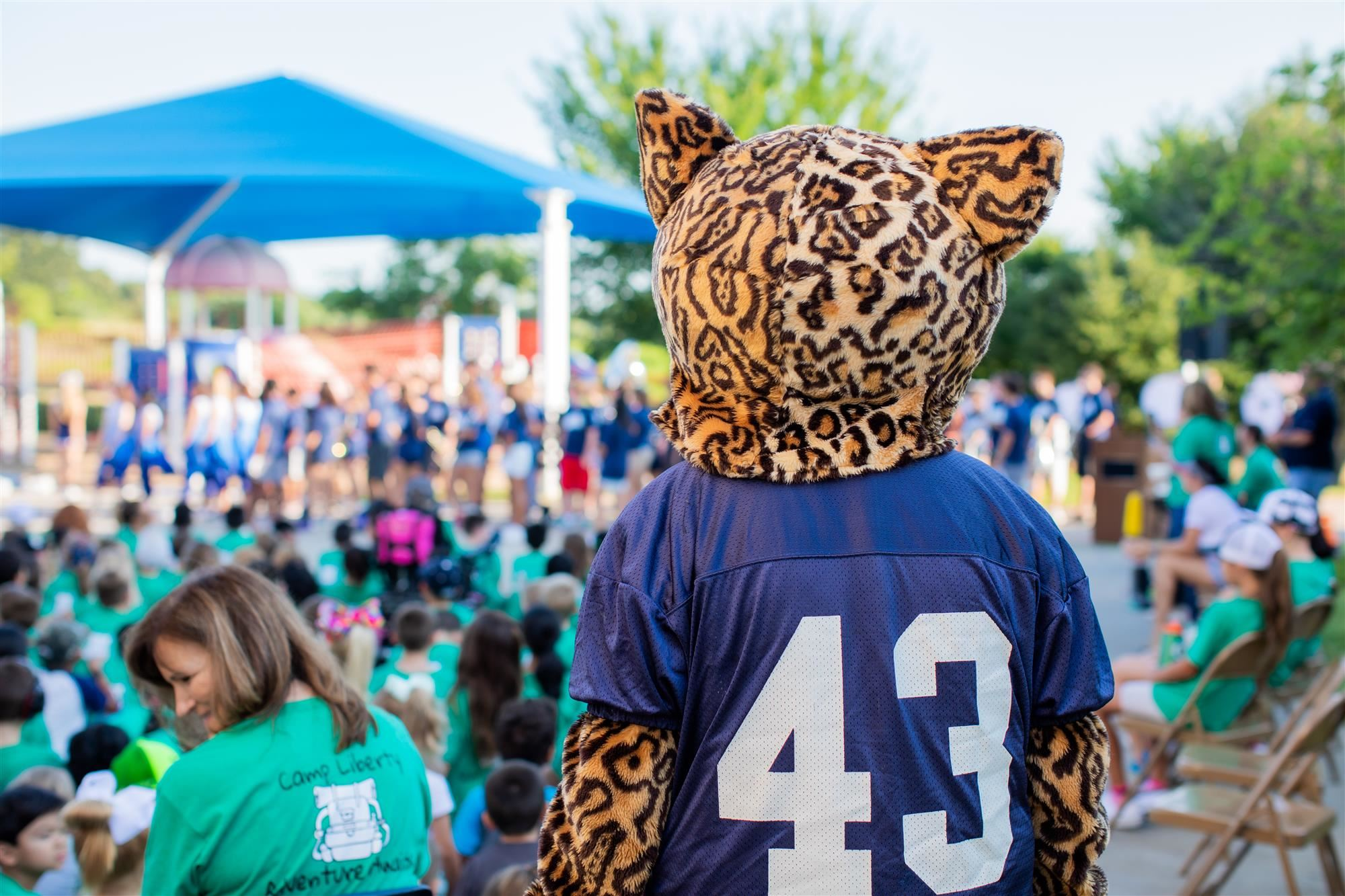 2019 liberty elementary school spirit assembly with fmhs mascot looking at crowd.
