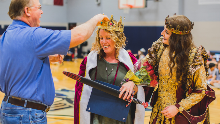 Former McKamy Middle School Teacher of the Year passes the crown to the new teacher of the year.
