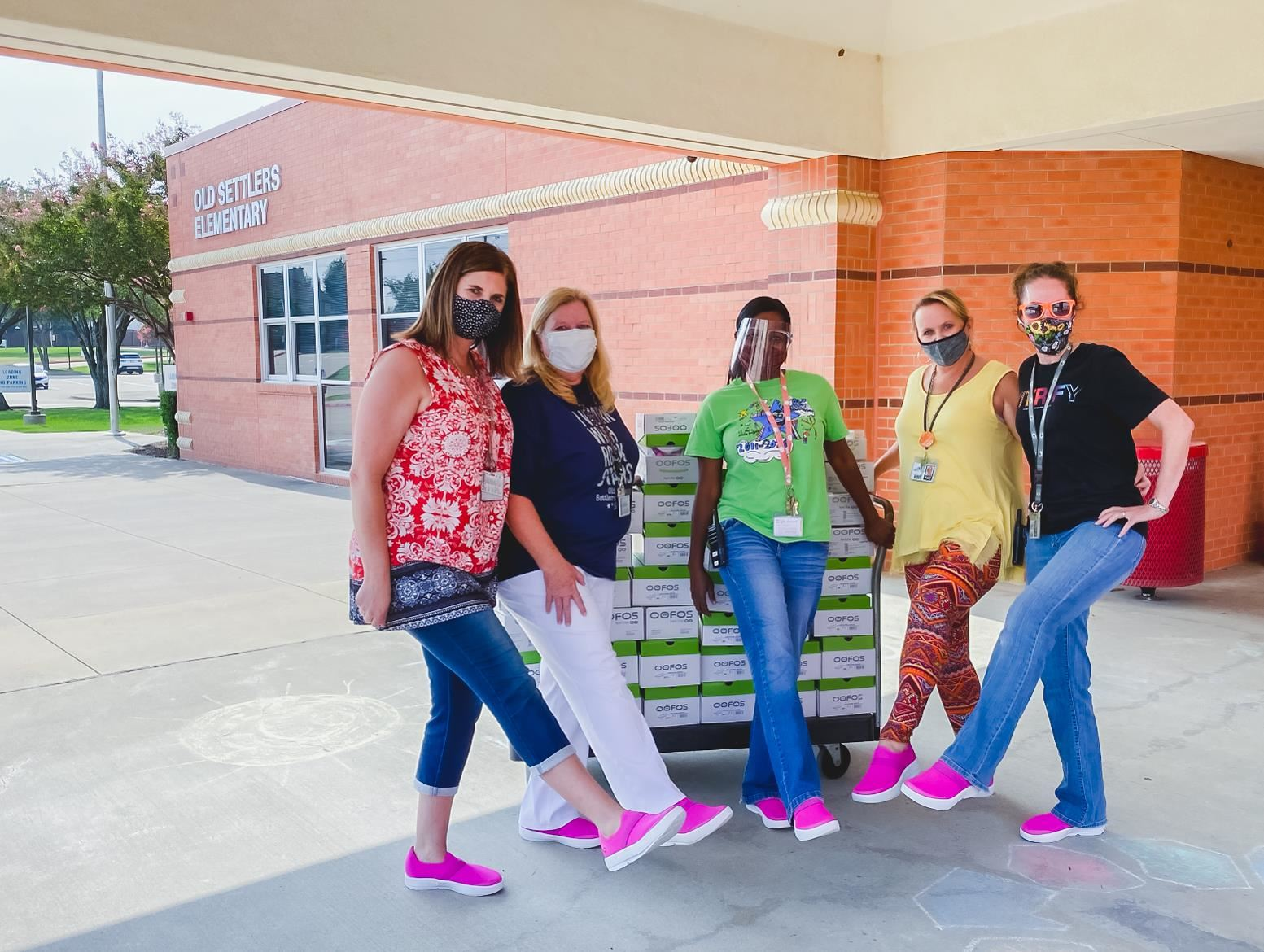 Old Settlers staff pose with their new OOFOS shoes on their feet. 2020