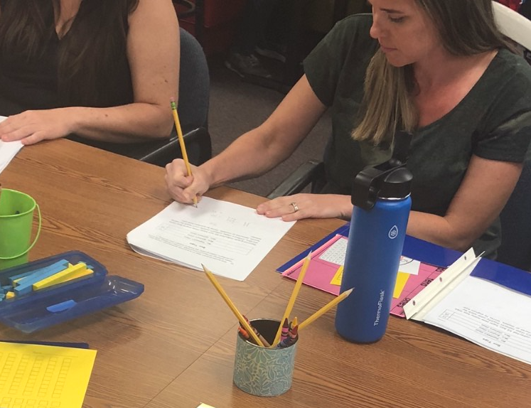 Bluebonnet Elementary parent works on solving second-grade math problems. 2016