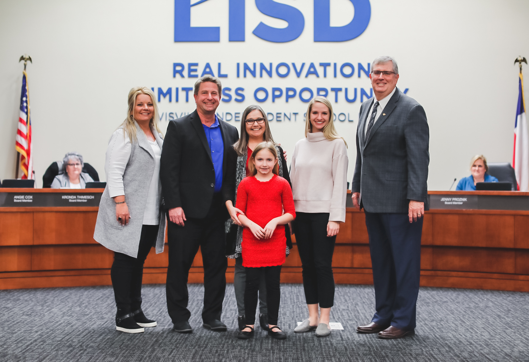 LISD's Director of Virtual Learning Dr. Chris Bigenho poses with family and LISD administration. Feb. 2020