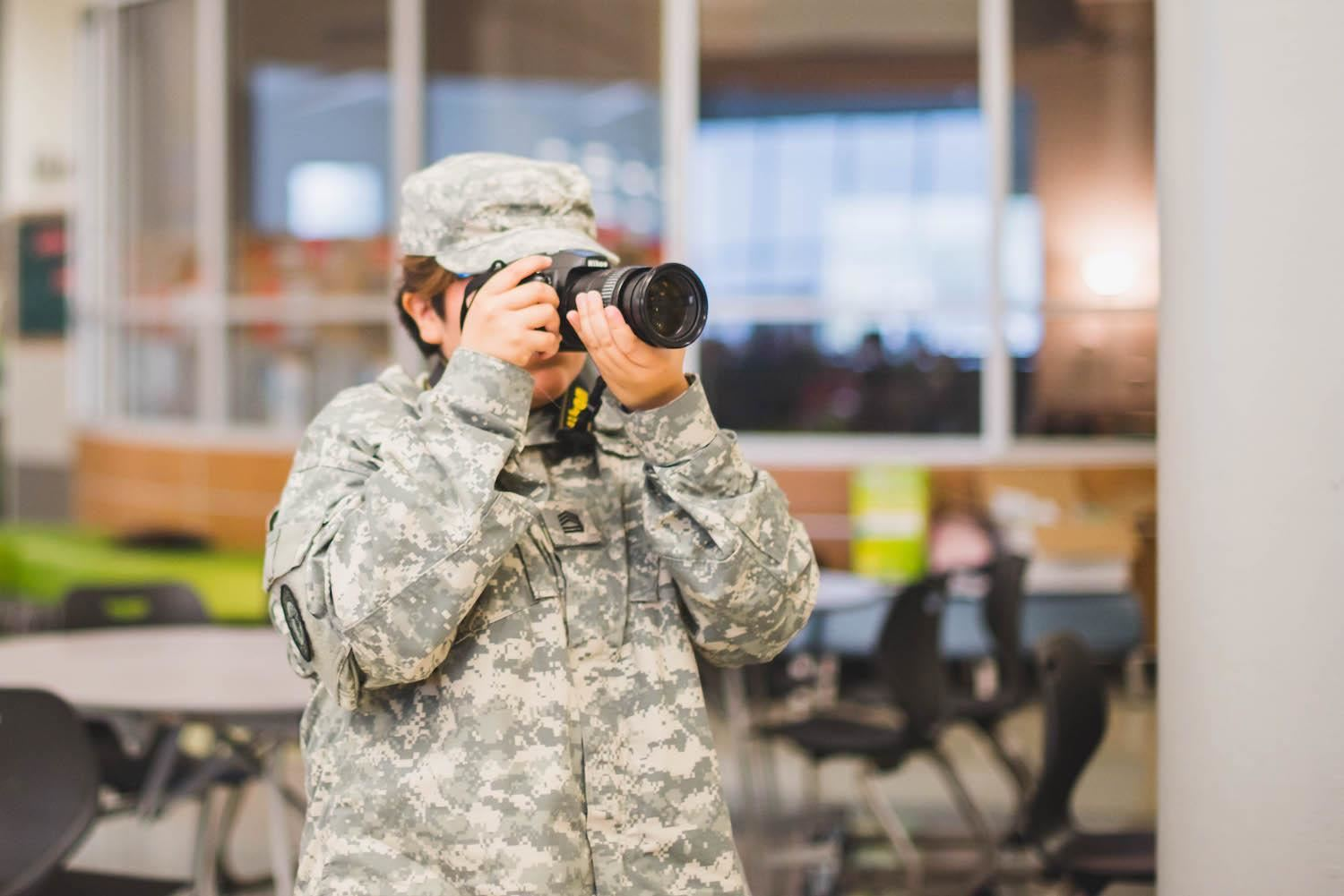 JROTC student takes photos at giving back event