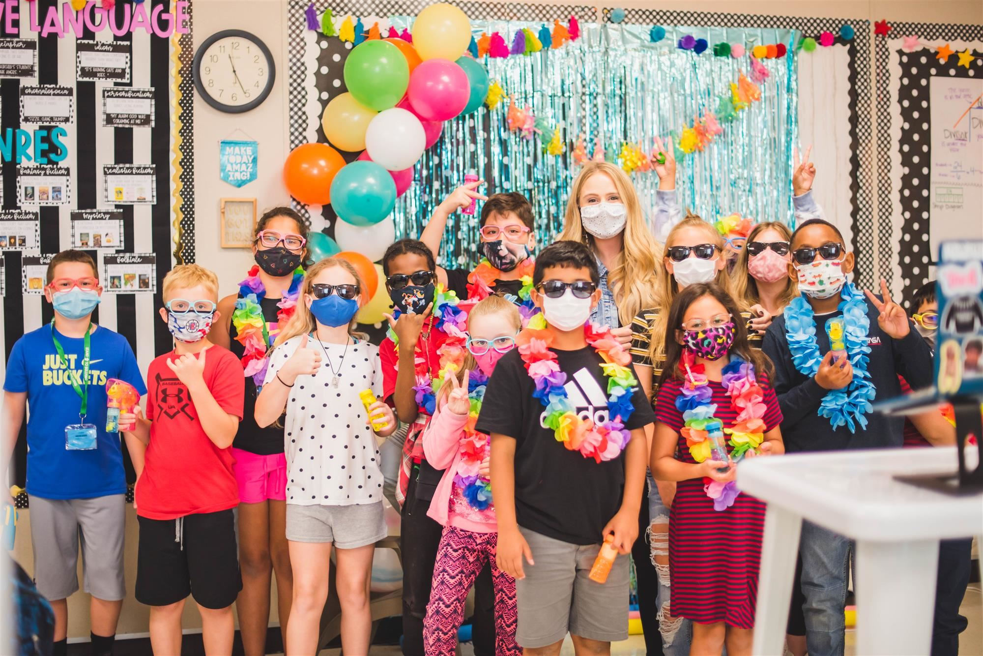 Fairchild's class smiles for group photo in masks