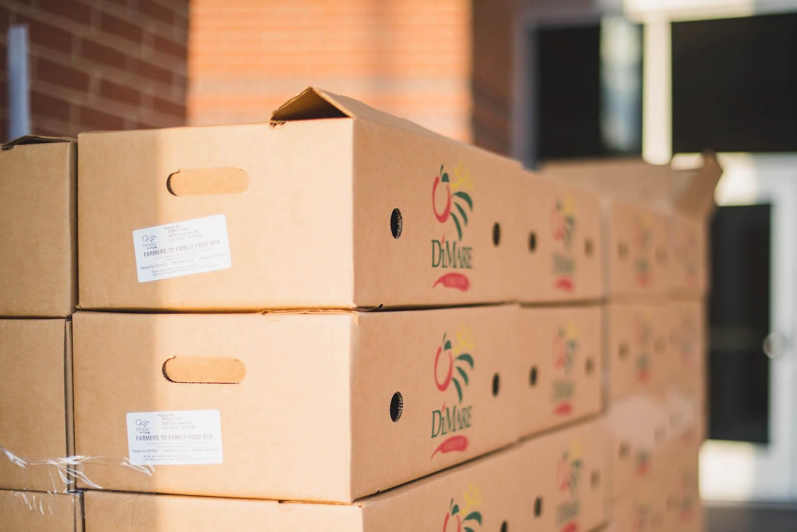 Food boxes stacked in front of school.