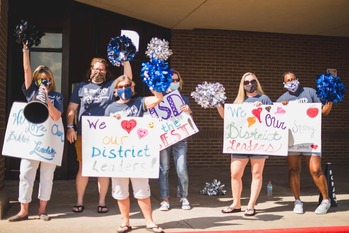 "campus staff thank administrative employees with signs of ""thanks"""