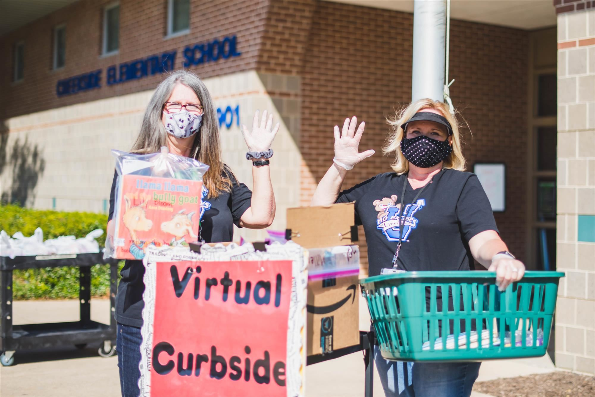 Librarians pass out books to virtual students