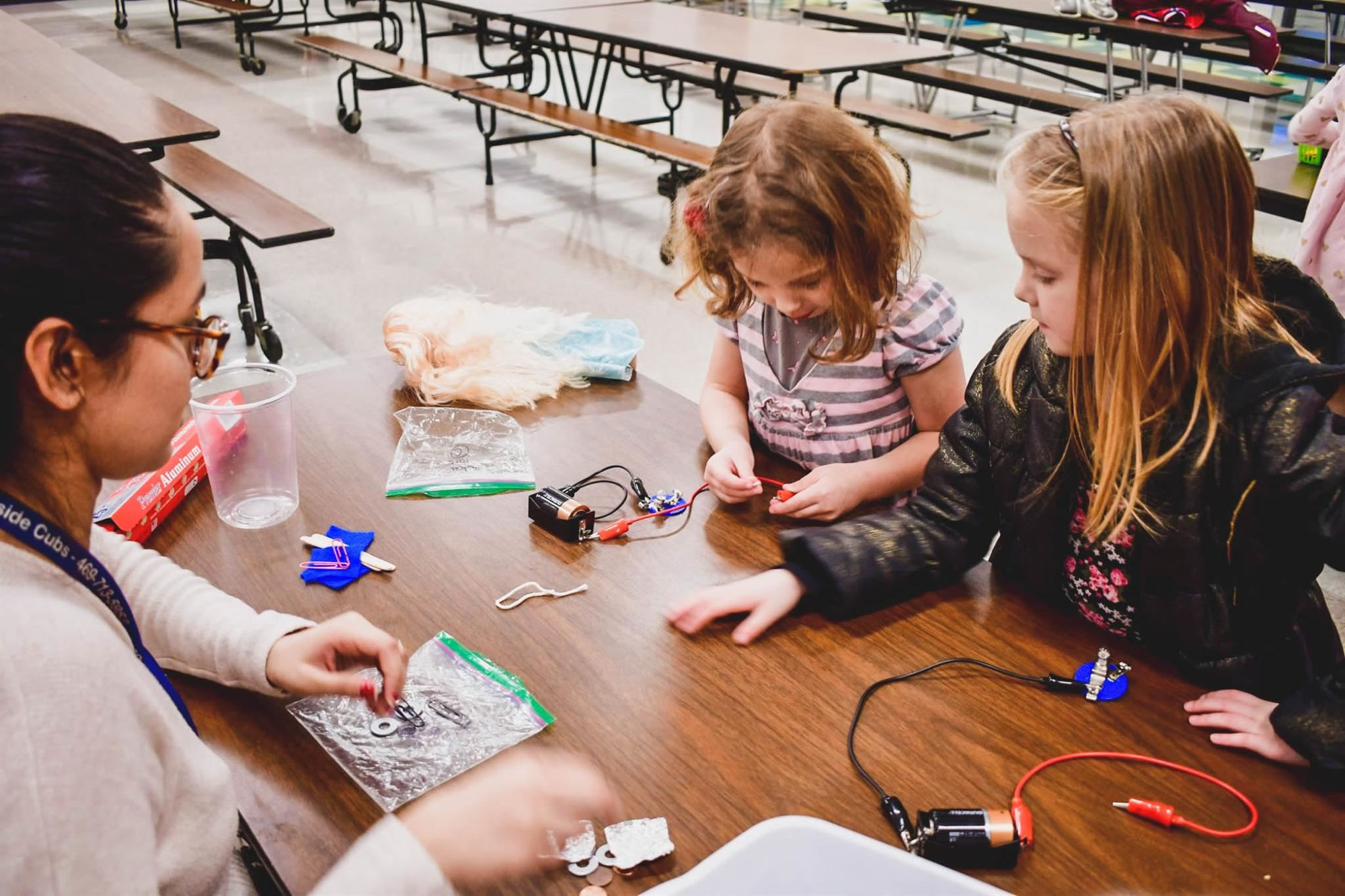Students work with circuits