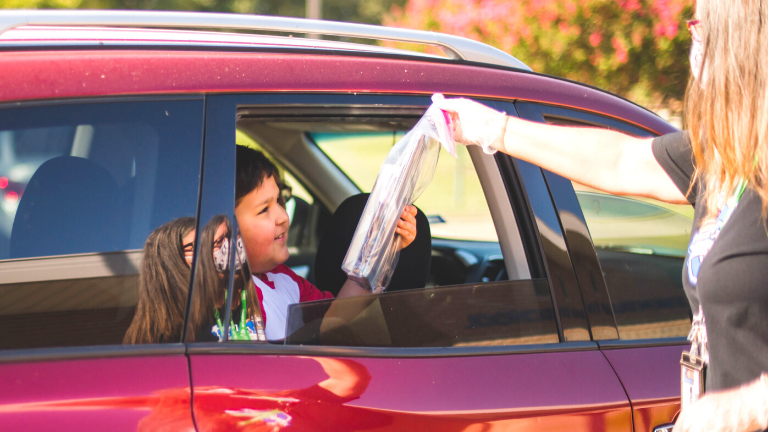 Creekside's Curbside Cubs Drive-Thru Book Service
