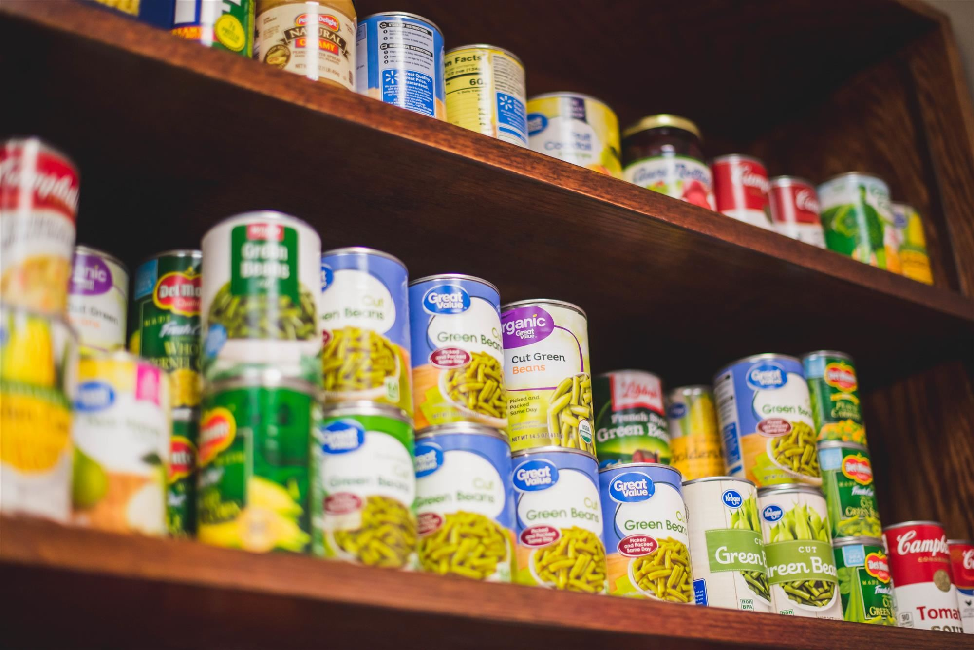 Canned foods on snack pantry shelf