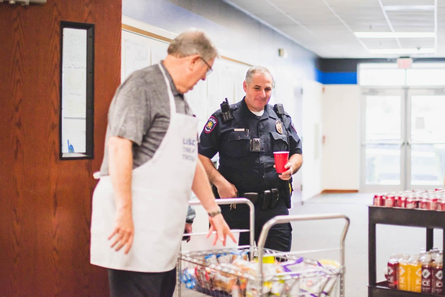 officer gets a snack from the treat trolley