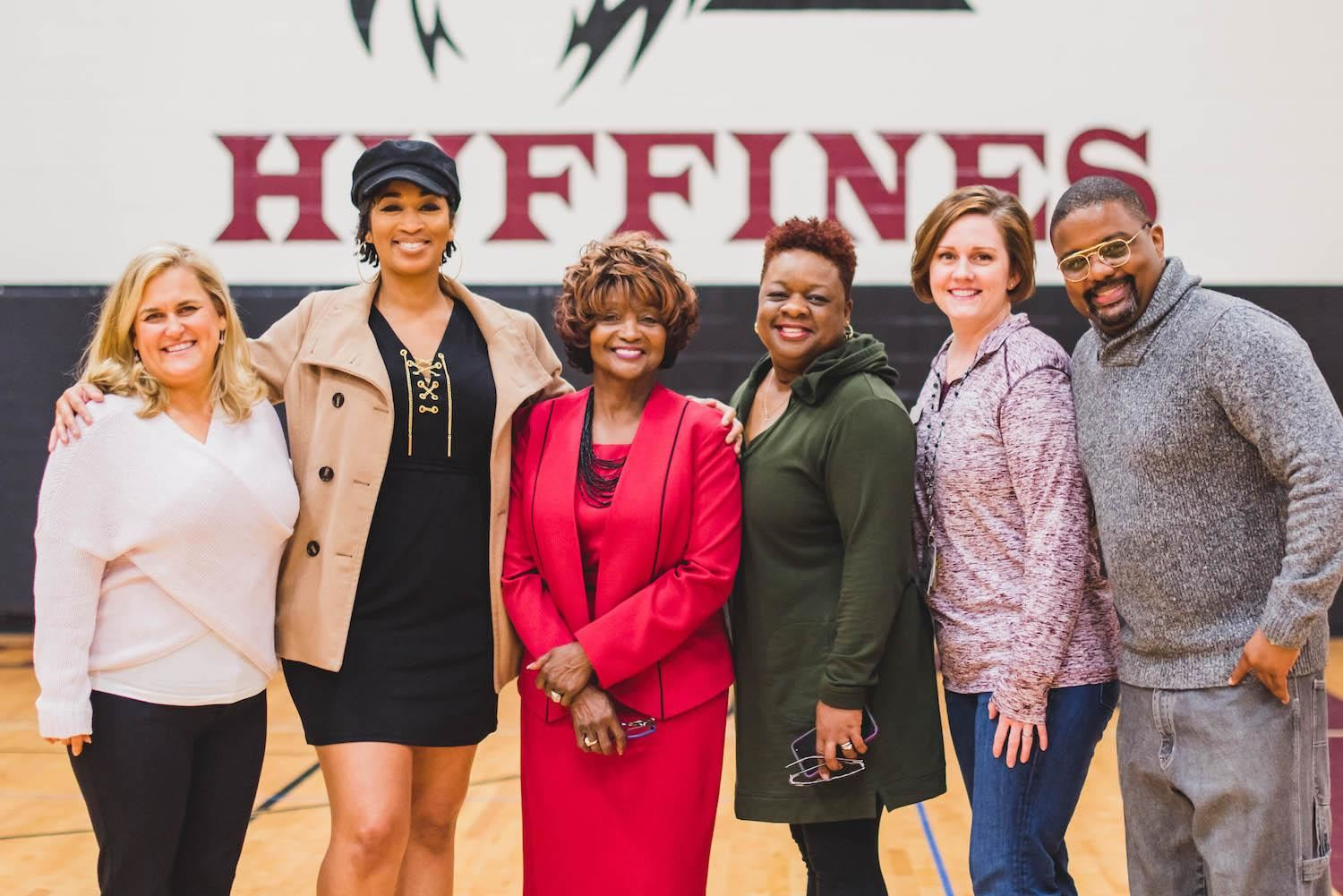 Group smiles at Huffines Black History Month celebration