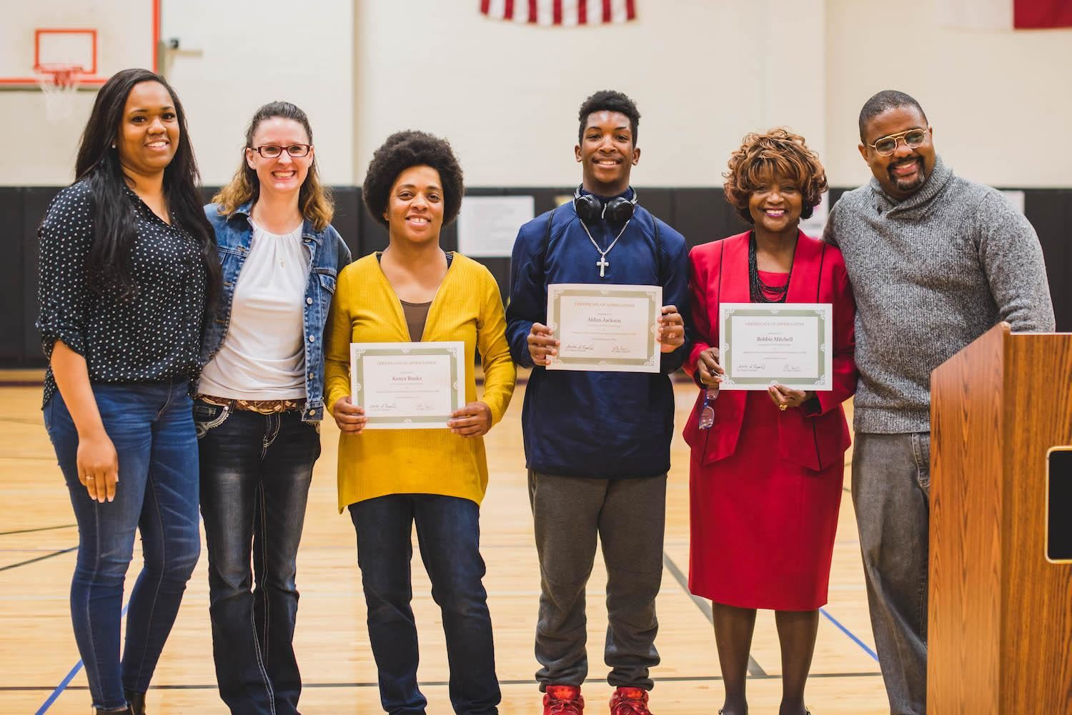 Groups smiles with certificates at Black History Month celebration