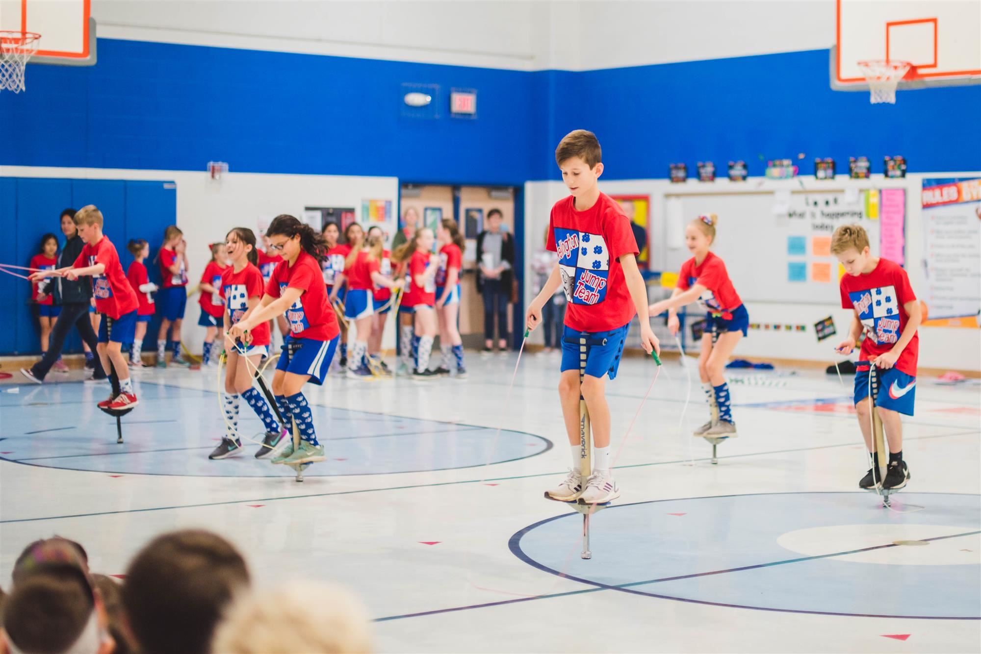 JUmp rope team performs with pogo sticks