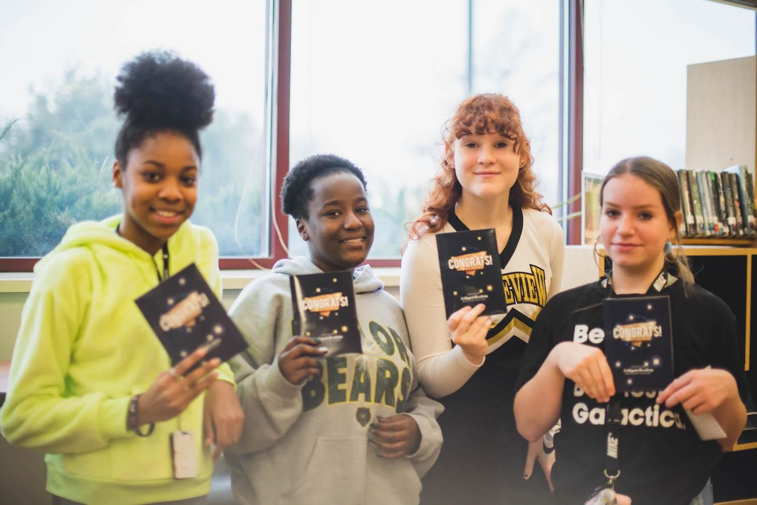 "lakview students smile with ""congrats"" cards"