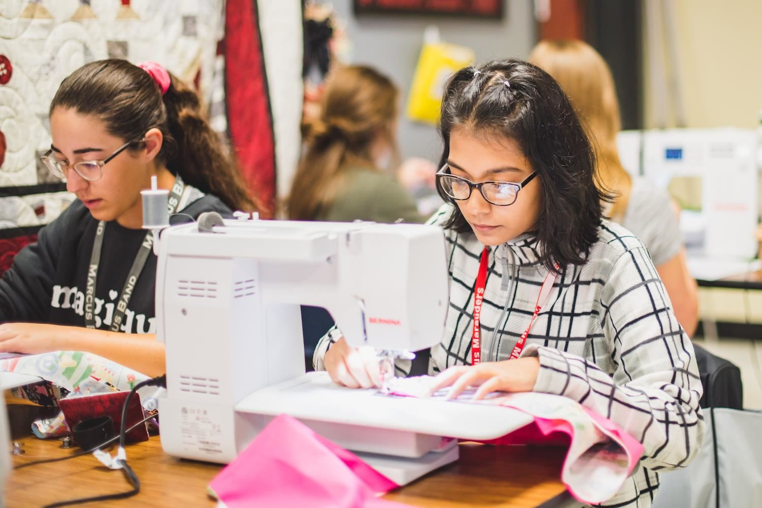 Students sew with sewing machine