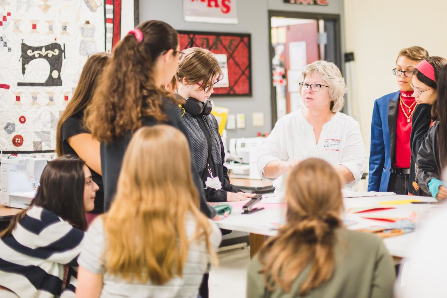 Guest, Connie Keller teaches students how to sew