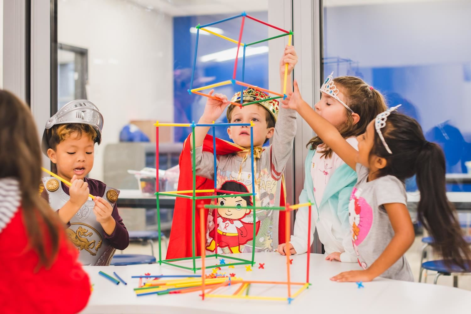 Students work together to build structure from straws