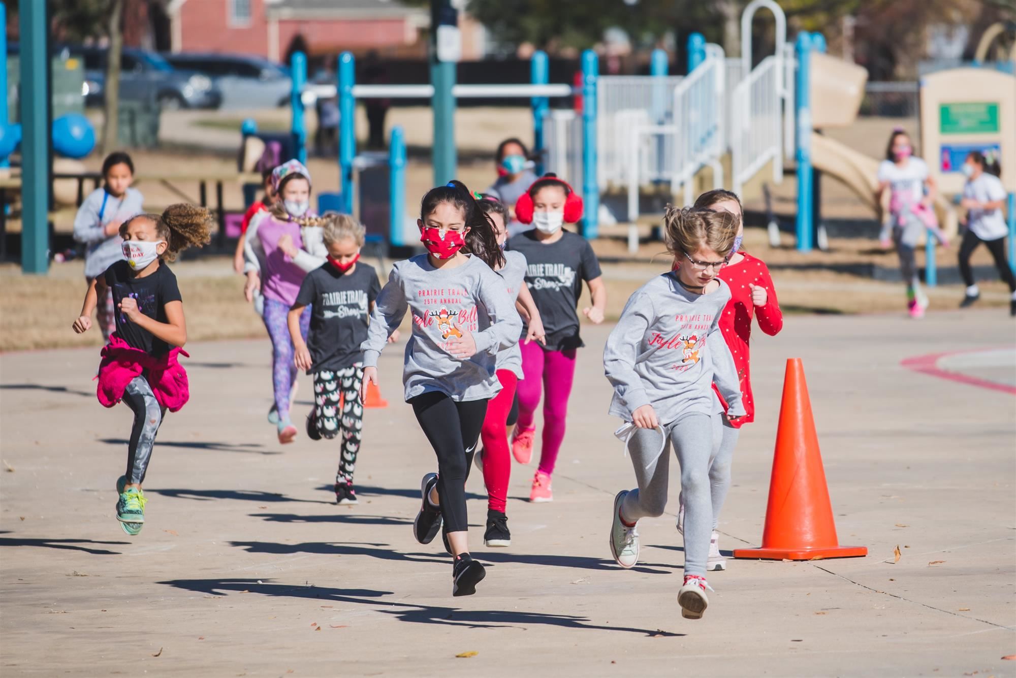 Students run in the Jingle Bell Jog