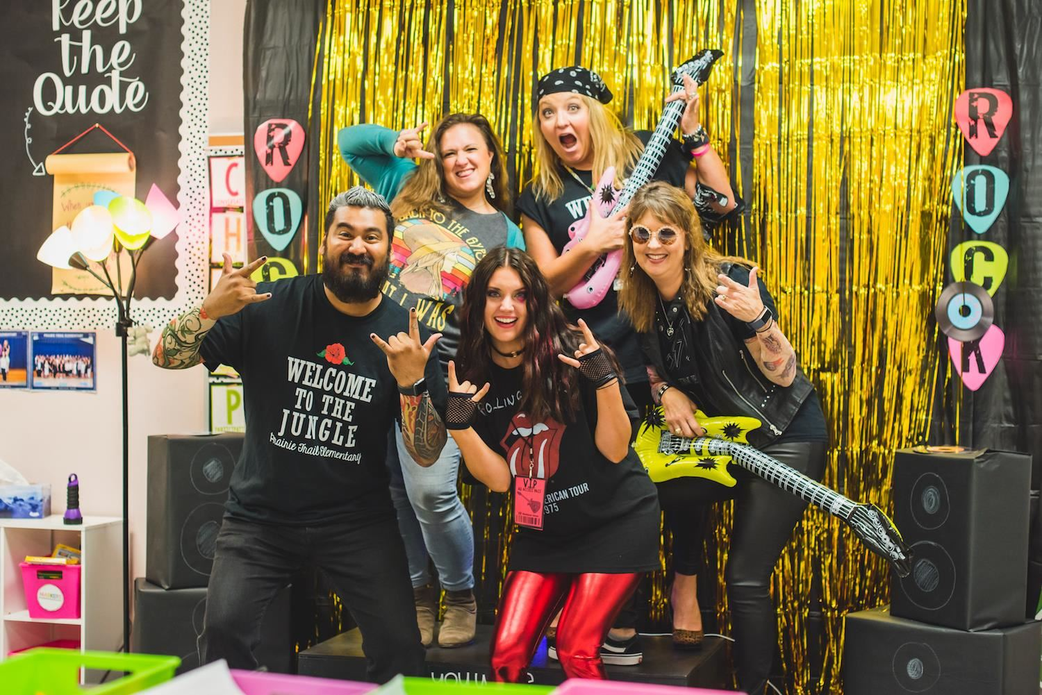 Five teachers dressed as rockstars