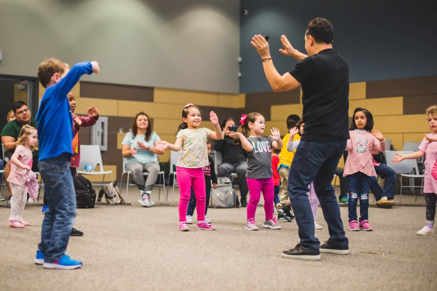 students dance along with instructor