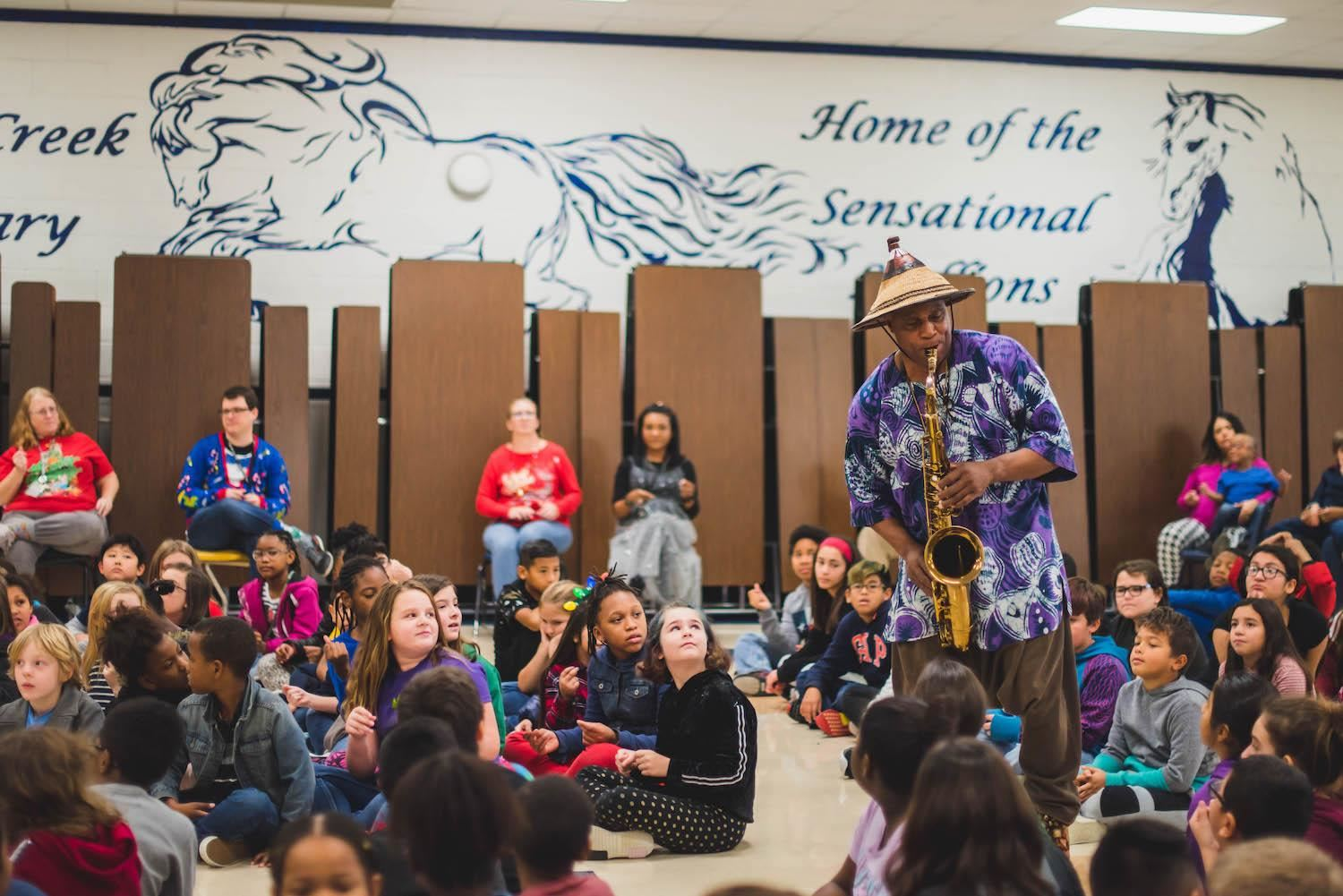 Saxaphone player plays music to students