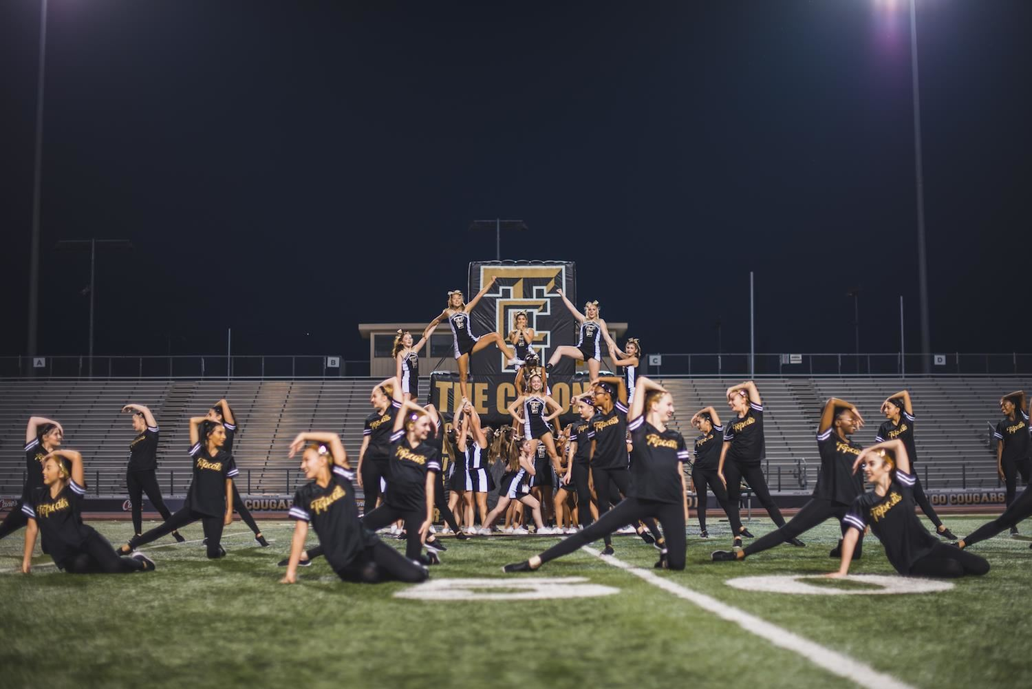 the colony cheer and dance teams do a routine together