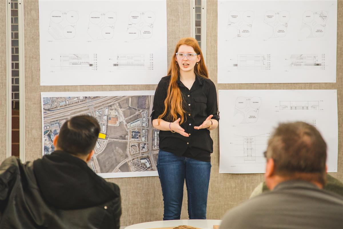 Student presents to architectural professionals.