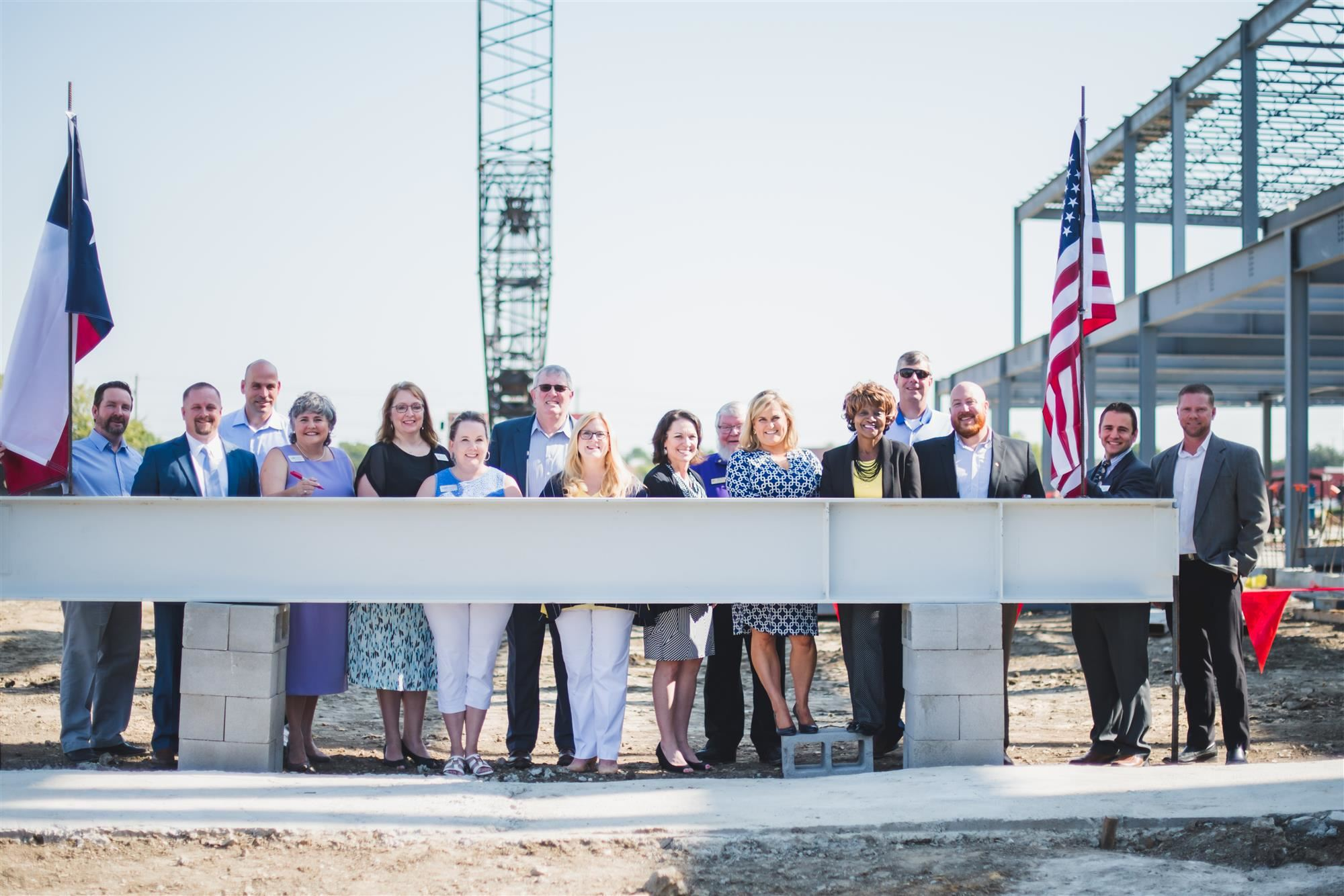 Lewisville ISD Board of Trustees, administrations and community dignitaries attend the topping out ceremony of TECC-West.