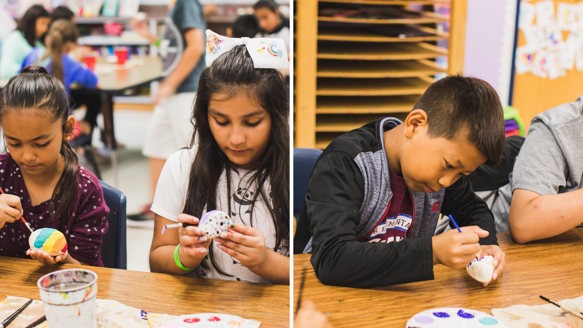 Students paint rocks together in 2019.
