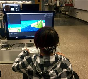 student working on video game
